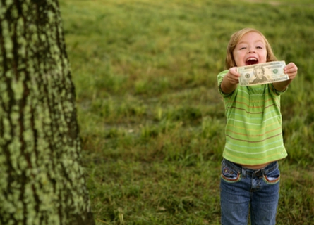 Sell Trees in Illinois - Walnut Timber Buyers - Little Girl Holding Tewnty Dollars Next to Tree