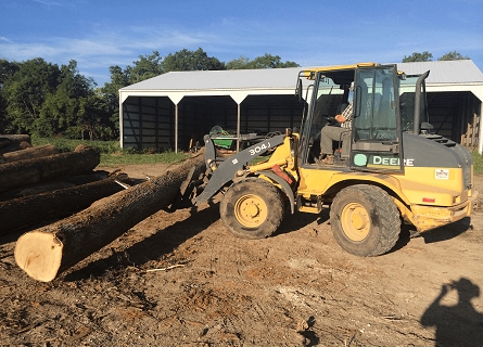 Licensed Timer Buyers tractor carrying logs in Cass County IL